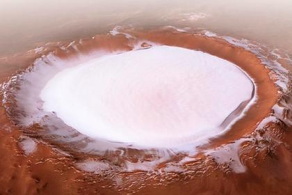 Раскрыто происхождение огромных резервуаров воды на Марсе