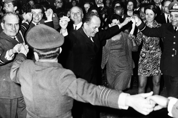 Greek Prime Minister George Papadopoulos dancing in the street with high ranking officers, at the barracks of the Greek Air Force during Easter celebrations, April 17th 1969. (Photo by Keystone/Hulton Archive/Getty Images)