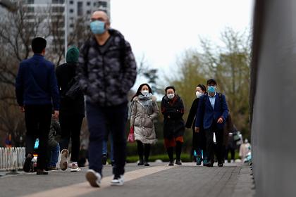 Китайский город закрыли на карантин из-за завезенного из России коронавируса