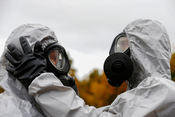 Specialists adjust protection gear during a civil protection functional exercise in case of nuclear disaster in Svencionys, Lithuania October 2, 2019.