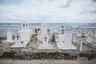Кладбище в деревне Джернок (Маджуро, Маршалловы острова) постепенно разрушается в результате подъема уровня моря. В июне 2014 года повышение уровня моря смыло останки 26 японских солдат Второй мировой войны на острове Санто.