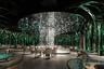 """На фото представлен интерьер китайского ресторана <a href=""""https://competition.adesignaward.com/design.php?ID=94318&utm_medium=website&utm_source=archdaily.com"""" target=""""_blank"""">Fengyuan</a>, находящегося в Гуанчжоу. Заведение открылось для посетителей в октябре 2018 года. Архитекторы Лили Се и Фан Хуан старались организовать пространство так, чтобы у посетителей ресторана сложилось ощущение игры в Lego.<br><br>Дизайнерская концепция отталкивается от фирменного блюда ресторана — курицы в кокосовом молоке. Позелененная сталь имитирует листья пальмы, а светильники-«капельки» и «весенние» столы погружают в атмосферу «фантастического леса»."""