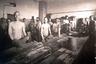 Изоляторы специального назначения ввел в советскую систему наказаний Исправительно-трудовой кодекс РСФСР 1924 года. Здесь содержались лица, приговоренные к лишению свободы со строгой изоляцией, которые не принадлежали к классу трудящихся и совершили преступления «в силу классовых привычек, взглядов и интересов». <br></br> На фото заключенные изготавливают валенки из овечьей шерсти при помощи специальных инструментов— массивных деревянных рубелей. Из-за особенностей производства в помещении постоянно была высокая влажность, поэтому заключенным приходилось работать обнаженными по пояс.