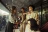 Примечательно, что витрины в советское время оформляли празднично, наряжая манекены в самые лучшие наряды из ассортимента.   <br> <br>  В 80-е годы мода стала авангардной, на прилавках появились кители и пиджаки с широкими плечами — как на снимке.