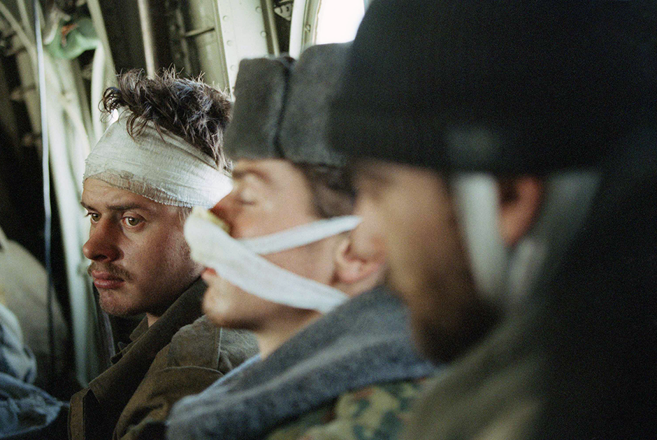 A wounded Russian soldier, being evacuated with his comrades, stares into space in a helicopter on his way out of Grozny, Feb. 3, 1995, as the fighting in the Chechen capital continues. The massive Russian force that invaded Chechnya has taken heavy losses against a small but determined guerrilla force. (AP Photo/Karsten Thielker)
