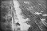 Выброшенный на берег (предположительно) пароход Eschersheim с грузом угля. Фотография сделана в районе Локкен (Дания) с самолета Юнкерс Ju-52 во время переброски дополнительного технического оборудования из Ольборг (Дания) в аэропорт Сула в Ставангере (Норвегия). Дания, 1940 год.