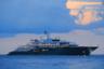Остроносая мегаяхта Radiant предназначалась российскому предпринимателю Борису Березовскому — он даже внес крупный задаток, но впоследствии из-за финансовых трудностей так и не смог ее выкупить. <br></br> В конце концов, за 320 миллионов долларов лодку приобрел арабский миллиардер Абдулла Аль-Футаим. Возвела ее судостроительная компания Lurssen, дизайн экстерьера был создан британцем Тимом Хейвудом, а интерьера — американцем Гленом Пушельбергом. <br></br> Судно со стальным корпусом и алюминиевыми надстройками оснащено несколькими бассейнами, вертолетной площадкой, комнатой для массажа, гидравлической плавательной платформой, кинотеатром, тренажерным залом и джакузи. <br></br> В общей сложности на 110-метровой Radiant вмещается 16 гостей и экипаж из 44 человек. Говорят, что там, помимо прочего, имеется крайне мощная водяная пушка, способная защитить пассажиров и экипаж от пиратских атак.