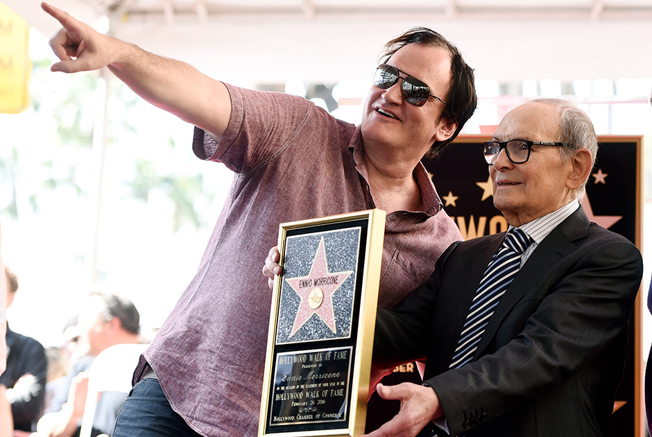 """Italian composer Ennio Morricone, right, poses for photographers with director Quentin Tarantino during a ceremony presenting Morricone with a star on the Hollywood Walk of Fame on Friday, Feb. 26, 2016, in Los Angeles. Morricone is nominated for an Academy Award for Best Original Score in Sunday's Oscars ceremony for Tarantino's film """"The Hateful Eight."""" (Photo by Chris Pizzello/Invision/AP)"""