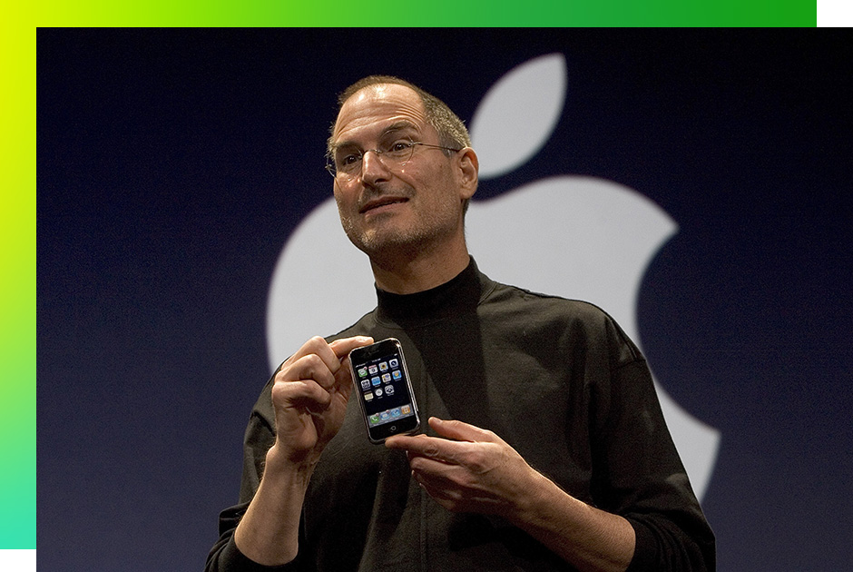 SAN FRANCISCO, CA - JANUARY 9: Apple CEO Steve Jobs holds up the new iPhone that was introduced at Macworld on January 9, 2007 in San Francisco, California. The new iPhone will combine a mobile phone, a widescreen iPod with touch controls and a internet communications device with the ability to use email, web browsing, maps and searching. The iPhone will start shipping in the US in June 2007.