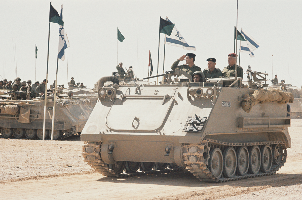 Chief of Staff David Elazar (1925-1976) reviews ranks of Israel Defense Force troops from an armoured personnel carrier as they line up with Patton and Centurion tanks in the Sinai Desert at the end of the country's biggest military exercises since the six-day war, Israel, 22nd March 1972. (Photo by