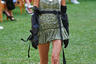 В своей новой весенне-летней коллекции люксовый итальянский бренд Philosophy совместил сразу несколько главных трендов грядущего года. Например, одна из участниц шоу продемонстрировала зрителям клетчатый сарафан, «рыбацкие» резиновые сапоги и вязаную шляпу-панамку, которая остается в моде на протяжении нескольких сезонов. Однако даже в ее летнем наряде видна отсылка к пандемии: на руках девушки — длинные резиновые перчатки, дополняющие стиль ее обуви. <br> <br> Само шоу проводилось на открытом воздухе: в качестве подиума организаторы выбрали газон, а гостей рассадили в удобные плетеные кресла.