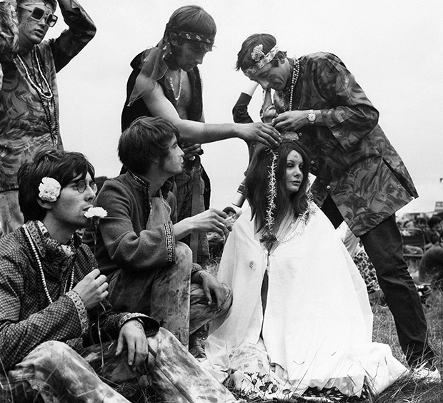 Hippies decorate each other with flowers on August 26, 1967 at Woburn Abbey, stately home of the Duke of Bedford at Woburn, England. (AP Photo)