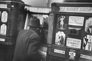 Man throughly engaged in the delights of coin-operated Peep Show machine featuring films of Beautiful Girls and Exotic Dancers in ALL DANCE SHOW (3 subjects-10 cents each) in Arcade on 42 St. in the tawdry Time Square area.