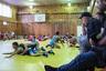 Академия единоборств имени М. Базарганова в Кизилюрте — одно из мест, где Хабиб начинал заниматься борьбой. Сейчас там устраивают местные детские соревнования. Отцы всегда приходят на турниры поболеть за сыновей. В академию приезжают тренироваться и иностранные спортсмены.