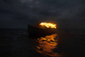Фотограф старался задействовать в своих работах изображения реальных объектов и локаций, а вместо графики использовал пиротехнические элементы и световые инсталляции. Так и на этом снимке — горящее судно плывет по воде, поэтому оно максимально плотно интегрировано в природную среду.
