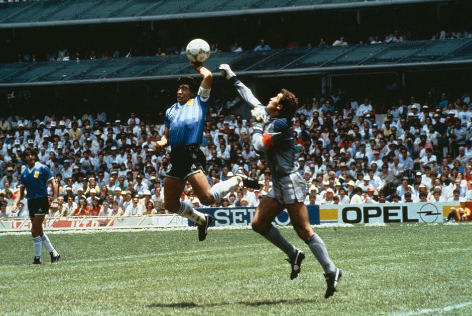 У многих болельщиков Марадона ассоциируется с фразой «Рука бога». Это часть цитаты, принадлежащей самому Диего, забившему мяч рукой в ворота сборной Англии в четвертьфинале чемпионата мира 1986 года. Судьи не заметили нарушения правил и засчитали гол, а на послематчевой конференции аргентинец заявил, что мяч был забит «отчасти головой Марадоны, а отчасти рукой бога».