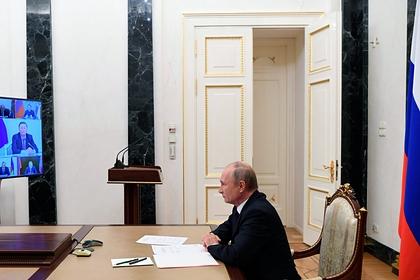 Путин сделал замечание чиновникам из-за шапок