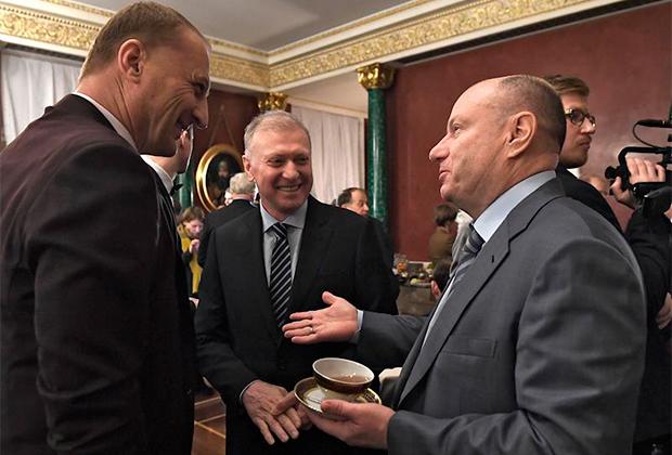 Слева направо: Леонид Казинец, Муса Бажаев и Владимир Потанин