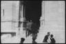 Немецкие военные выходят из базилики Сакре-Кер на вершине холма Монмартр. Париж, Франция, 1940 год.