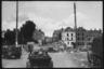 Колонна немецких войск движется по разрушенному городу. Франция, 1940 год.