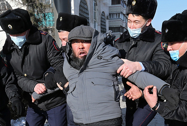 A protester is taken away by law enforcement officers during a rally held by opposition supporters on the parliamentary election day in Almaty, Kazakhstan January 10, 2021.