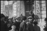 Советский фотокорреспондент снимает людей на улице города. Ботошани, Румыния. Апрель 1944 года.