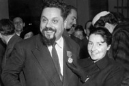 Dr. Alain Bombard with his wife at the Naval Museum in Paris, France, Feb. 15, 1957, after being presented with the Cross and Red Ribbon of the 'Legion of Honour', by Roger Duveau, the French Minister for the merchant navy. The award was made to Bombard for his crossing of the Atlantic Ocean in a rubber dinghy in December 1952. (AP Photo)