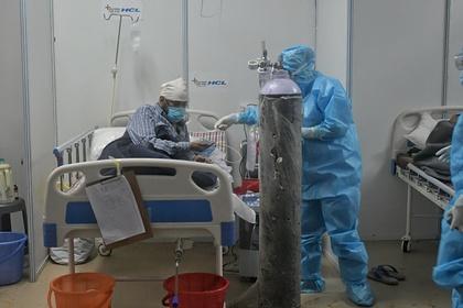 Пациент с коронавирусом в больнице Дели, Индия