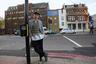 """Архитектурная фантазия Чиннека в 2013 году добралась и до Лондона — скульптор <a href=""""https://www.dezeen.com/2013/12/06/alex-chinneck-upside-down-building-london/"""" target=""""_blank"""">установил</a> на здании к югу от моста Блэкфрайерс необычный фасад. Он выбрал заброшенную безликую постройку, где в XVIII веке держали лошадей. Со временем здание потеряло вид и сильно обветшало. Чиннек решил вернуть его к жизни в рамках фестиваля выставок Merge. Он буквально перевернул стену с ног на голову — ярко-синяя входная дверь с рекламной вывеской оказалась сверху, а около асфальта расположились окна. Задумка получила два названия «Под погодой, но над Луной» (Under the weather but over the Moon) и «Шахтер на Луне» (Miner on the Moon). Перевернутый фасад сделали из плоского кирпича и полистирола. Чиннек реализовал задуманное на пожертвования и пользовался помощью добровольцев."""
