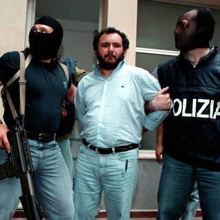 Джованни Бруско (в центре)