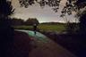 """В 2014 году голландский художник Даан Русегаарде (Daan Roosegaarde) и компания Heijmans Infrastructure, занимающаяся созданием «здоровой» окружающей среды, создали в городе Эйндховен светящуюся дорогу. Проект был посвящен 125-летию со дня смерти нидерландского художника-постимпрессиониста Винсента Ван Гога.<br><br>Тропа <a href=""""https://archello.com/project/van-gogh-roosegaarde-bicycle-path"""" target=""""_blank"""">проходит</a> по участку, где деятель искусств жил и гулял в 1883-1885 годах. Велодорожка состоит из тысячи маленьких камней, которые днем заряжаются от солнечного света, а в темное время суток начинают сверкать. Заряда <a href=""""https://www.youtube.com/watch?v=eVFYhbHpfqU"""" target=""""_blank"""">хватает</a> до восьми часов. Дизайн был вдохновлен картиной Ван Гога «Звездная ночь». Необычный проект высоко оценили критики — он <a href=""""https://www.studioroosegaarde.net/project/van-gogh-path"""" target=""""_blank"""">получил</a> престижную награду в области дизайна от датской компании The Index Project и стал победителем на ежегодной неделе голландского дизайна."""