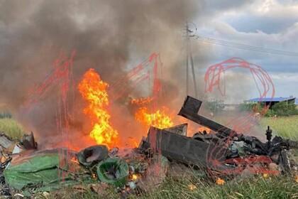 Опубликовано фото с места крушения вертолета в Ленинградской области