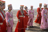 В одежде калмыков сохранилось наследие воинов-предков, живших в Монгольском ханстве. Напоминанием об их героическом прошлом, о родстве с потомками Чингисхана был монгольский халат — верхняя простеганная одежда, которую носили исключительно старики. Зимой верхней одеждой молодым калмыкам служили овчинные тулупы и шубы из мерлушки (шкурка ягненка в возрасте до двух недель), а летом они надевали кафтаны иличапаны, подпоясанныекушаками.  Костюм простых калмыцких женщин был незатейлив. Он состоял из длинной широкой блузы и шаровар. Женские летние кафтаны от мужских отличались лишь тем, что не имели рукавов. Под кафтан калмычки надевали платье терлег из яркой ткани, украшенное вышивкой с растительным орнаментом по краям рукавов и подолу. Женщины из богатых семей имели в своем гардеробе собольи шубы. В отличие от мужчин и девушек, никогда не выходивших из дома не подпоясавшись, замужние женщины и вдовы поясов не носили.  Чтобы калмыцкая знать могла украшать себя драгоценностями, ежегодно совершались продолжительные, порой опасные походы в Китай, Тибет и Монголию. Оттуда купцы привозили украшения и шелк. Больше всего ценились серьги, особенно если на них было пять драгоценных камней. Любая уважающая себя калмычка имела серьги, а мужчина считал долгом одарить мать своих детей дорогими подарками.  Ювелирным украшениям приписывались магические свойства, их появление в народном костюме было овеяно мифами. Калмыки считали, что если человек не носит серьги, то в загробном мире с его ушей будут свисать змеи. Женщина носила серьги в обоих ушах, девушка — только в правом ухе, а мужчина — в левом. Новорожденным детям также прокалывали мочки и надевали золотые серьги с камнями красного цвета, чтобы защитить от злых духов.