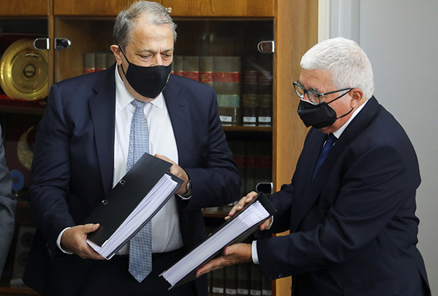 Myron Nicolatos, a former Cyprus' Chief Justice and head of a commission investigating a discredited cash-for-passports scheme, hands over findings to Cyprus' Attorney-General Georgios Savvides in Nicosia, Cyprus June 7, 2021.