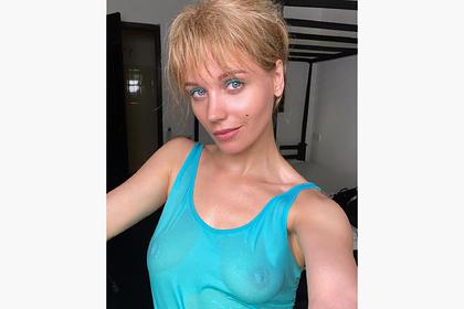 Кристина Асмус взволновала поклонников фотографией в мокрой майке