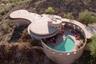 """Последнее творение Райта, которое он спроектировал незадолго до смерти в 1959 году,— дом для семьи Лайкс недалеко от города Финикс в американской Аризоне. Строительство уникального особняка на горе в 1967 году <a href=""""https://archive.curbed.com/2020/9/16/21439851/frank-lloyd-wright-norman-lykes-house-for-sale-phoenix"""" target=""""_blank"""">завершил</a> ученик архитектора Джон Рэттенбери (John Rattenbury).<br><br>Дом состоит из нескольких конструкций цилиндрической формы и <a href=""""https://www.elledecoration.ru/news/architecture/5-domov-frenka-lloida-raita-kotorye-mozhno-kupit-pryamo-seichas-id6826109/"""" target=""""_blank"""">занимает</a> более 287 квадратных метров. Постройка словно <a href=""""https://www.admagazine.ru/real-estate/poslednij-dom-sproektirovannyj-frenkom-llojdom-rajtom-vystavili-na-aukcion"""" target=""""_blank"""">вырастает</a> из горного массива, а цвет фасада не сильно выделяется на фоне ландшафта. Внутри размещались пять маленьких спален, три ванные комнаты, кухня и другие помещения. Спустя время новые владельцы провели в доме масштабный ремонт — из имеющихся комнат они оборудовали три большие спальни и просторную гостиную с видом на каньон. На территории также есть бассейн и терраса.<br><br>Здание неоднократно выставляли на продажу. В 2016 году за него попросили 3,6 миллиона долларов, однако покупатель не нашелся. Год спустя дом <a href=""""https://apnews.com/article/4dcd0bd35bab49f680eb2cc66ea4550a?utm_medium=APWestRegion&utm_source=Twitter&utm_campaign=SocialFlow"""" target=""""_blank"""">продали</a> на аукционе за 1,7 миллиона долларов. Новый владелец сохранил имя в тайне и поделился планами приезжать в дом на отдых. В 2020 году постройку решили сдавать в аренду почти за 16 тысяч долларов в месяц, а спустя некоторое время снова вернули на рынок почти за 8 миллионов долларов."""