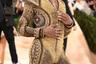 Американский рэперLilNasXизвестен своими эпатажными модными решениями: только в начале сентября он поделился с подписчиками снимком в образе беременного мужчины. Первая для музыканта Met Gala не стала исключением, ведь на балу он сменил сразу три наряда модного дома Versace. Последним стал облегающий комбинезон, полностью покрытый блестящими золотистыми кристаллами. Его образ также украсили массивные черные лоферы и золотые стрелки на веках.