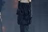 Креативный директор Saint Laurent Энтони Ваккарелло создал коллекцию, посвященную Паломе Пикассо, — подруге Сен-Лорана, чей стиль десятилетиями вдохновлял дизайнера. Шоу прошло на фоне Эйфелевой башни под искусственным дождем. Линейка включила в себя мужские пиджаки с широкими плечами, силуэты в духе 1970-х годов, облегающие комбинезоны и крупные украшения. Но и тут не обошлось без обнажающих грудь нарядов: вслед за другими модельерами Ваккарелло показал, что женщины имеют право ходить топлес наравне с мужчинами.